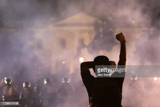 Man holds up his fist during a protest near the White House on May 31, 2020 in Washington, DC. Minneapolis police officer Derek Chauvin was arrested...