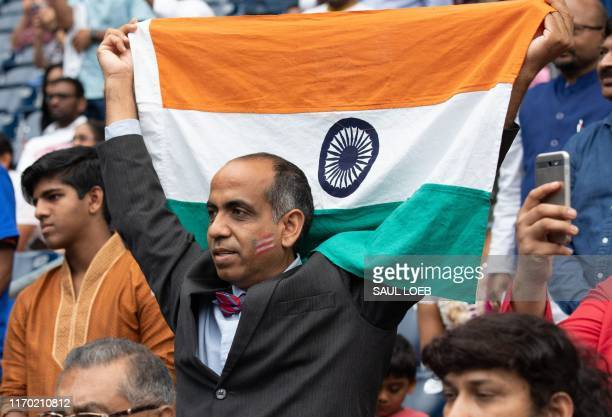A man holds up the falg of India as US President Donald Trump and Indian Prime Minister Narendra Modi attend Howdy Modi at NRG Stadium in Houston...