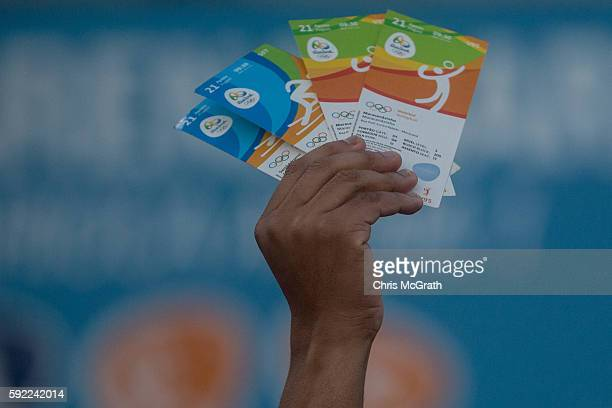 A man holds up tickets to sell or swap outside a venue inside Olympic Park on Day 15 of the Rio 2016 Olympic Games on August 19 2016 in Rio de...