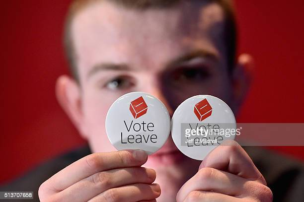 A man holds vote leave EU badges at the Scottish Conservative Party spring conference on March 4 2016 in Edinburgh Scotland Prime Minister David...