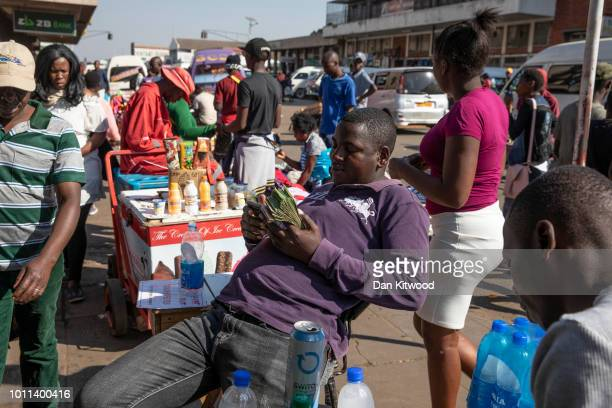 A man holds Zimbabwean Dollar Bond Notes on August 05 2018 in Harare Zimbabwe Zimbabwe Electoral Commission officials have announced the reelection...