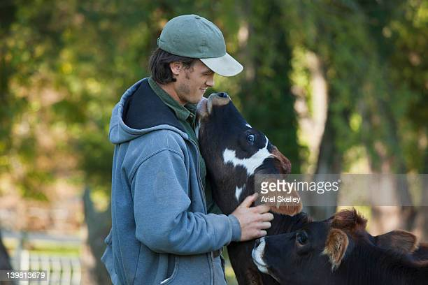 Man hugging calf