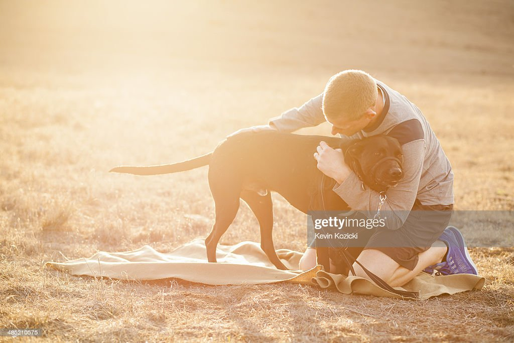 Man hugging dog : Stock Photo