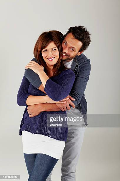 Man hugging his beautiful wife from behind