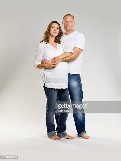 Man hugging pregnant wife