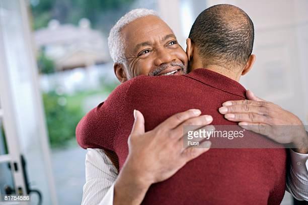 Man Hugging Senior Father