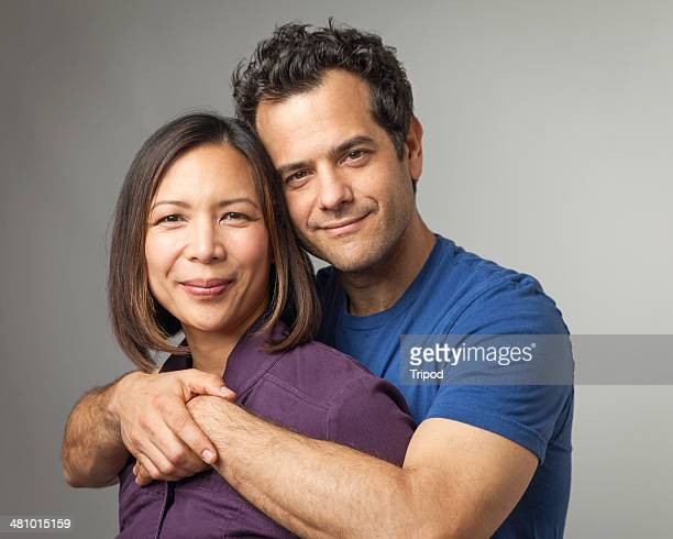 Man hugging woman from behind, portrait
