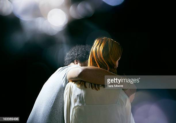man hugging woman with lens flare - rear view stock pictures, royalty-free photos & images