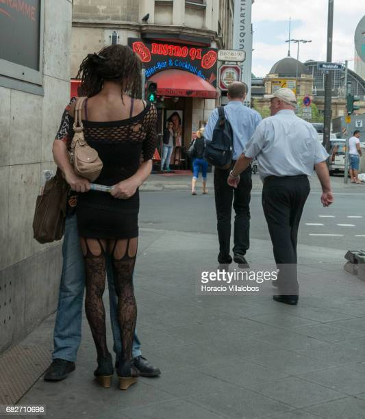 A man hugs a transvestite prostitute at the corner of Taunusstrasse and Mosselstrasse in the Redlight district on July 30 Frankfurt Germany The...