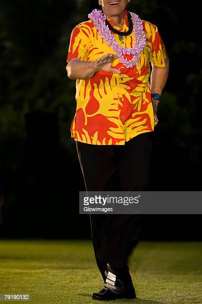 Man hula dancing in a lawn, Waikiki Beach, Honolulu, Oahu, Hawaii Islands, USA