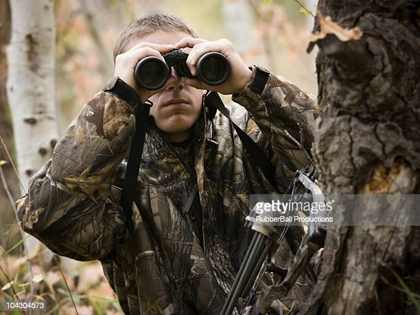 man hunting in the wilderness - camouflage clothing stock pictures, royalty-free photos & images