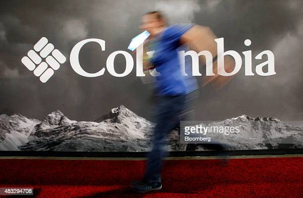 A man hurries past the Columbia Sportswear Co booth during the 2015 Outdoor Retailer Summer Market show at the Salt Palace Convention Center in Salt...