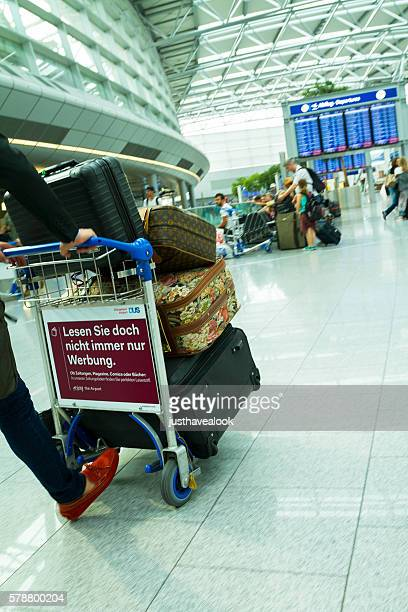 Man hurry with luggage in airport