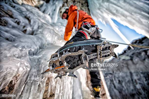 a man ice climbing on a frozen waterfall in colorado - robb reece stock-fotos und bilder