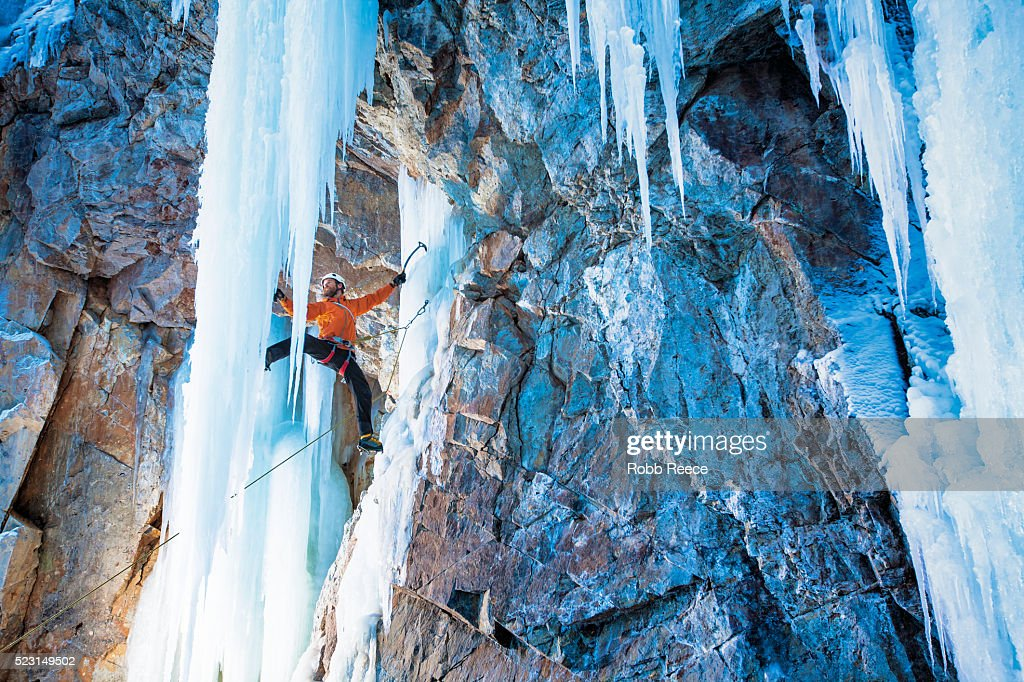 A man ice climbing on frozen waterfall in Lake City, Colorado : Stock Photo