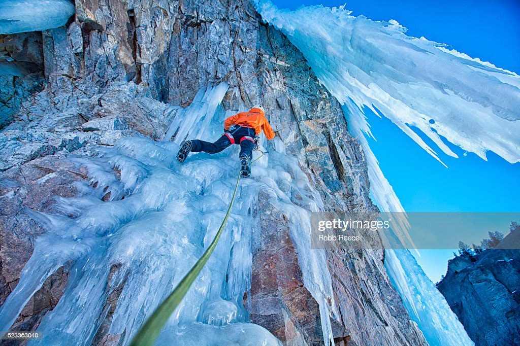 Man ice climbing with rope : Stock Photo