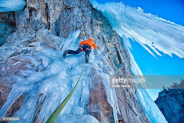 man ice climbing with rope - robb reece stock photos and pictures