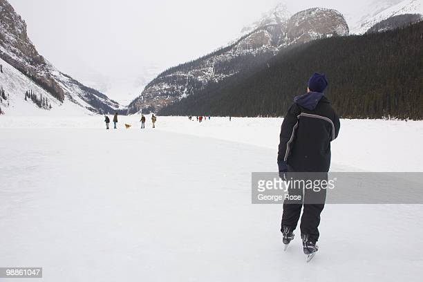 A man ice skates on a frozen Lake Louise as seen in this 2010 Lake Louise Canada late morning photo The resort was hit by a late spring snowstorm