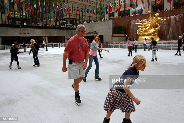 A man ice skates wearing shorts at the Rockefeller Center ice rink on its opening day for the winter season October 13 2008 in New York City...
