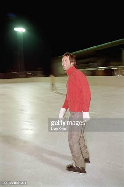 Man ice skating (blurred motion)