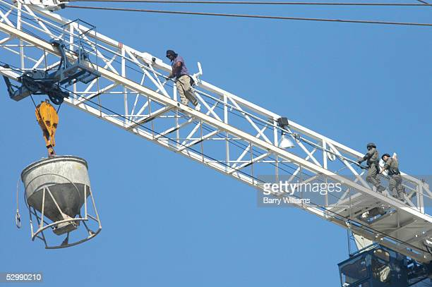 A man identified as Carl Roland of Clearwater Florida walks away from police on a construction crane May 27 2005 in Atlanta Georgia Roland who is...