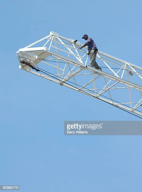 A man identified as Carl Roland of Clearwater Florida walks on a construction crane May 27 2005 in Atlanta Georgia Roland who is accused of murdering...