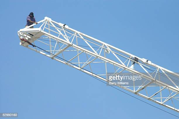A man identified as Carl Roland of Clearwater Florida walks to the end of a construction crane May 27 2005 in Atlanta Georgia Roland who is accused...