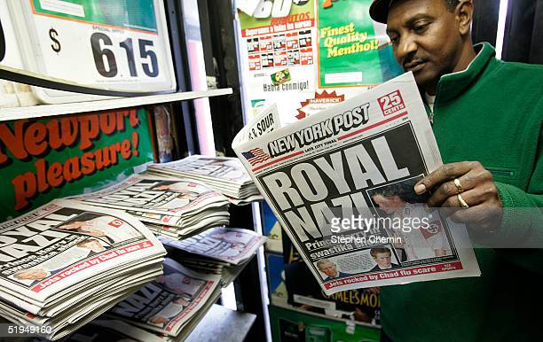 """Man identified as Hussein reads a copy of the New York Post newspaper featuring a """"Royal Nazi"""" headline January 13, 2005 in New York City. British..."""