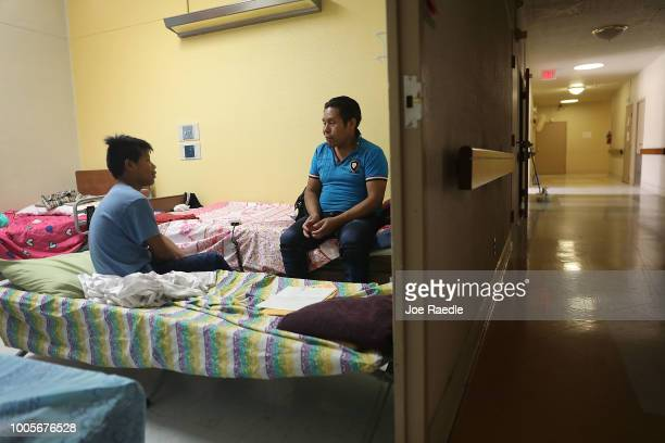 A man identified only as Domingo and his son Nicolas relax together in an Annunciation House facility after they were reunited on July 26 2018 in El...