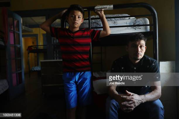 A man identified only as Jose sits with his son Wilson as they are cared for in an Annunciation House facility after they were reunited on July 21...