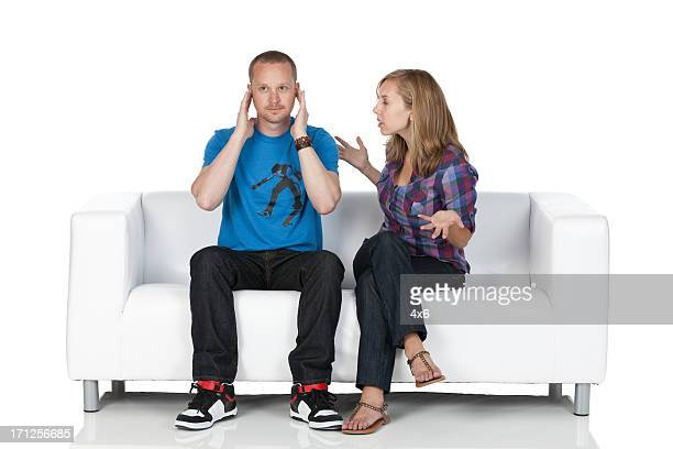 Man ignoring his girlfriend's talks