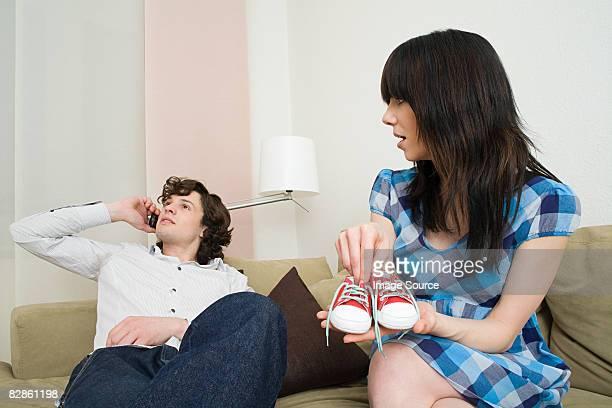 Man ignoring pregnant wife