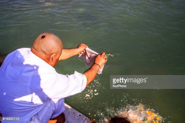 A man immersion ashes of his ancestor into ganga river in Haridwar Uttrakhand India on 8th Feb 2018According to hindu culture Har ki Pauri one of the...