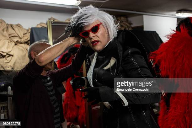 A man impersonating 'Cruella de Vil' of the '101 Dalmatians' animated film attends the Italian Doll Convention on May 19 2018 in Milan Italy Italian...
