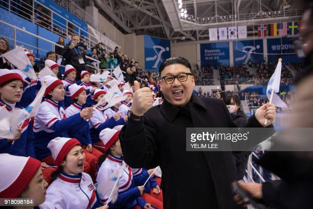 TOPSHOT A man impersonating North Korean leader Kim Jong Un gestures as he stands before North Korean cheerleaders attending the Unified Korean ice...
