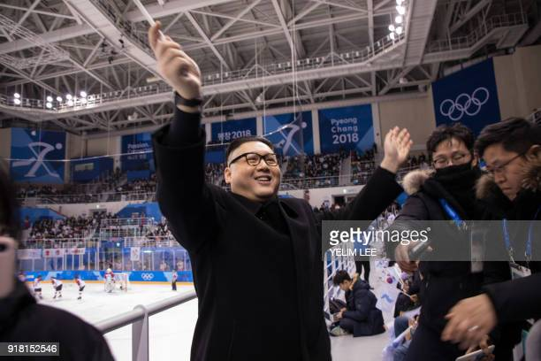 A man impersonating North Korean leader Kim Jong Un waves a unified Korean flag before North Korean cheerleaders attending the Unified Korean ice...