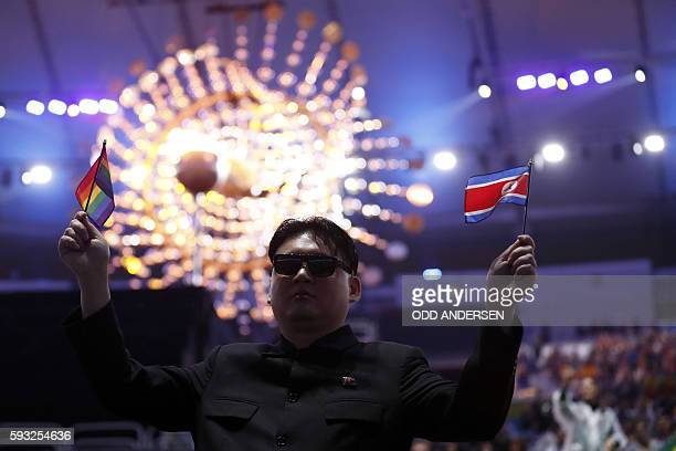 TOPSHOT A man impersonating North Korea's Kim Jongun attends the closing ceremony of the Rio 2016 Olympic Games at the Maracana stadium in Rio de...