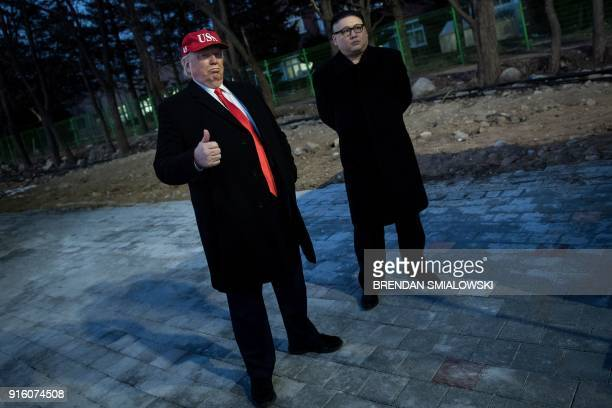 TOPSHOT A man impersonating US President Donald Trump and another impersonating Kim Jongun wait to enter the opening ceremony of the Pyeongchang 2018...
