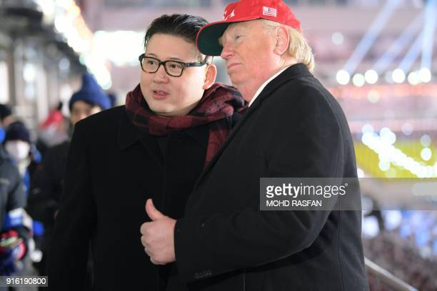 A man impersonating US President Donald Trump and another impersonating Kim Jongun pose in the stands during the opening ceremony of the Pyeongchang...