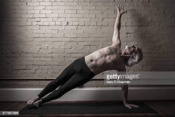 Man in 60's doing yoga