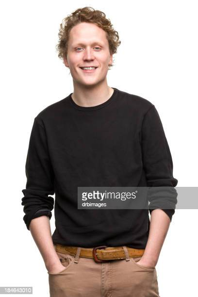 man in a black shirt with curly hair posing for a portrait - zwart shirt stockfoto's en -beelden