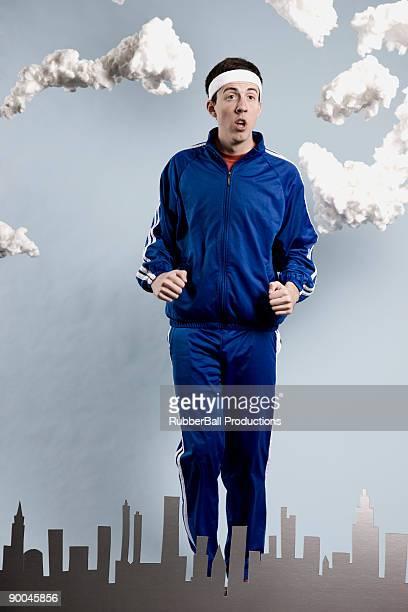 mann in eine blau-trainingsanzug - trainingsanzug stock-fotos und bilder