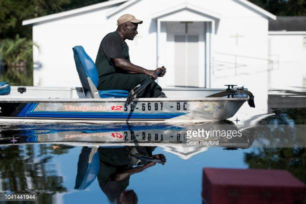 Man in a boat navigates floodwaters from the Waccamaw River caused by Hurricane Florence on September 26, 2018 in Bucksport, South Carolina. Nearly...