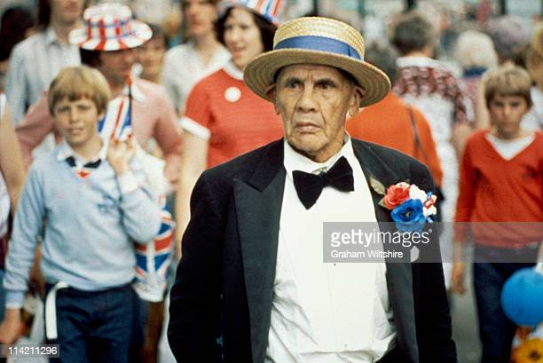 A man in a bow tie and straw boater celebrates the royal wedding of Prince Charles and Lady Diana Spencer on The Mall in London 29th July 1981