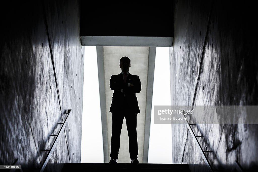 Man walks into the light : News Photo