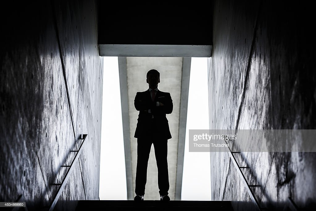 A man in a business suit at the end of a staircase on August 07, 2014 in Berlin, Germany.