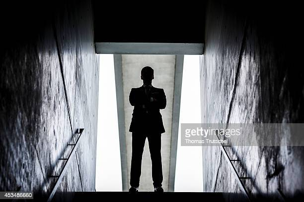 A man in a business suit at the end of a staircase on August 07 2014 in Berlin Germany