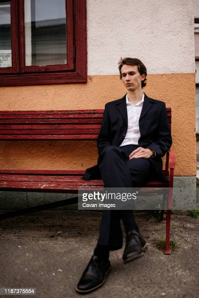 man in a business suit sitting on an old bench - leather shoe stock pictures, royalty-free photos & images
