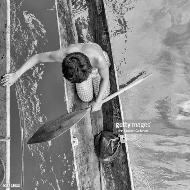 Man in a canoe in the Mentawai Islands