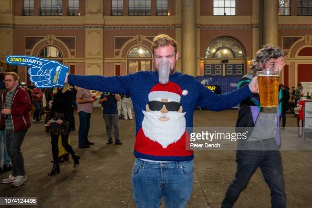 A man in a Christmas jumper at the Fans Village in Alexandra Palace on December 16 2018 in London England